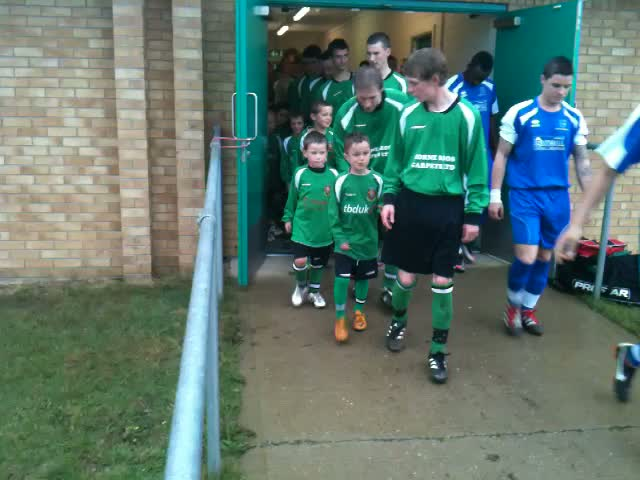 Junior & Senior Players Walk Out Together.